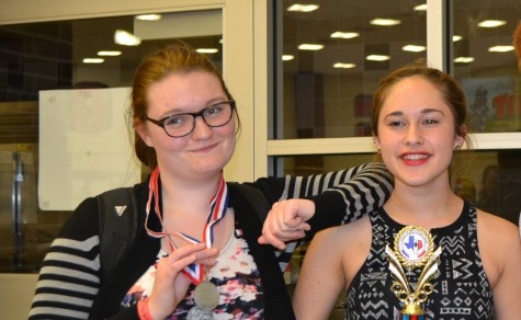 Juniors Iris Cronin and McKenna Gessner revel in their first place victories at French Symposium.