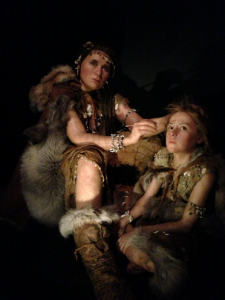 Wax sculptures from the exhibit represent early homo sapiens who were alive at the time the cave was painted.