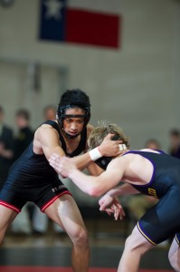 Senior captain Sean Yuan takes on a Kinkaid wrestler at last year's War on the Floor where the Mavericks broke the Falcons' two-year streak with an 87-66 win.