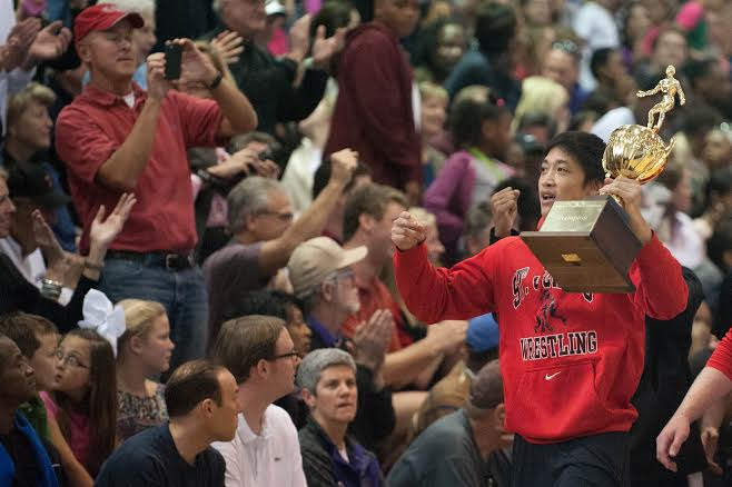 Senior captain Sean Yuan cheers on classmates at the SPC basketball championship after the wrestling team's victory.