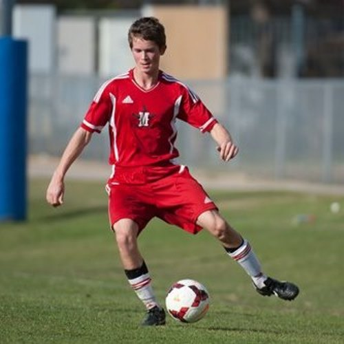 Rising junior Joe Faraguna dribbles a soccer ball. The boys' soccer team placed 6th in Division 1 of SPC this year.