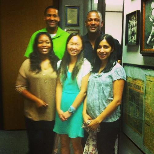 Lillian poses with her financial brokerage coworkers.