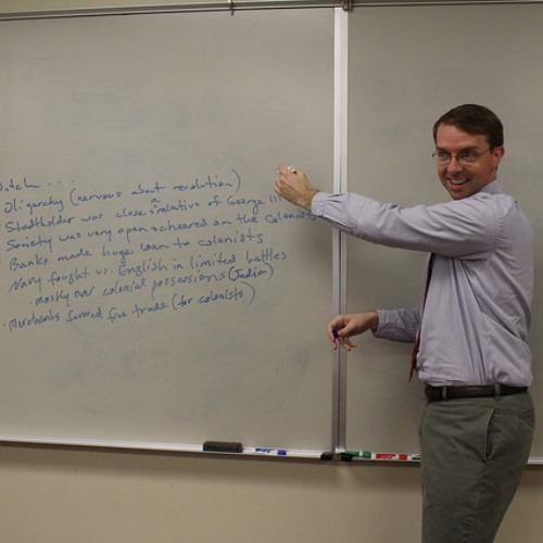 New history teacher Bailey Duncan writes down key points on the board during his United States history class.
