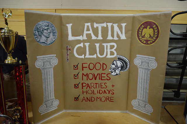 Latin Club leaders displayed trophies from competitions beside their posters.
