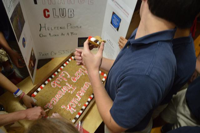 Maverick Microfinance Club lured new members with cookie cake.