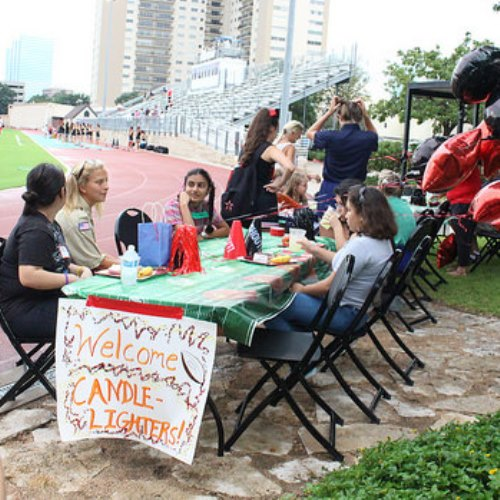Junior Nicholas Vogeley and senior Kate Bomar organized a tailgate for Candlelighter families before the football game.