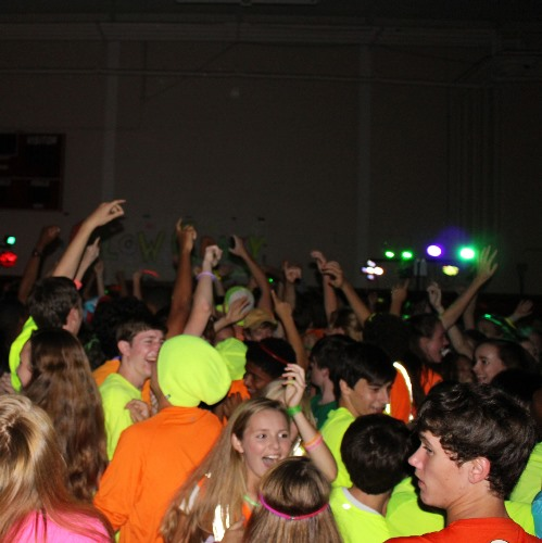 Colors glow, electric music pulses at Homecoming dance