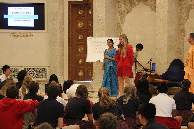Freshman Morgan Sholeen volunteers to sing a prayer at the Hare Krishna temple. (Emily Ragauss)