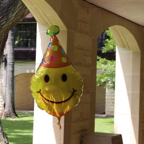 Surprises like this smiley balloon hanging in the Quad remind students of the simple joys in life. Groups like Wellness Club try to ease the stress of students, improve their state of mind and encourage healthy habits.