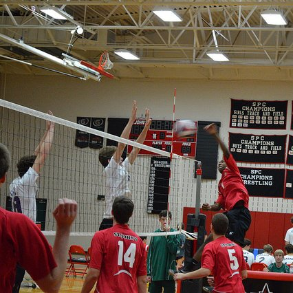 Boys' volleyball plays in the gym, where they hope to hang a championship banner after a victory on Saturday.
