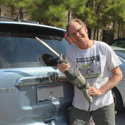 Although art teacher Dan Havel owns a Honda CR-V, a commercial featuring the same make and model infringed on his Inversion House installation, as pictured on his shirt. Havel used power saws and similar tools to create 'Inversion.'