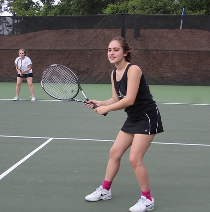 Junior McKenna Gessner plays doubles. Last year, the team won 8th place in SPC.
