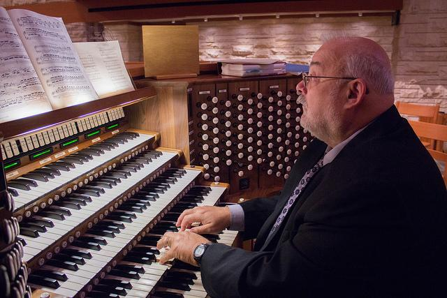 Accompanist+Donald+Doucet+plays+the+organ+in+the+back+of+St.+John+the+Divine+during+Chapel.+Doucet+has+been+accompanying+the+schools+choirs+and+bands+since+2002.