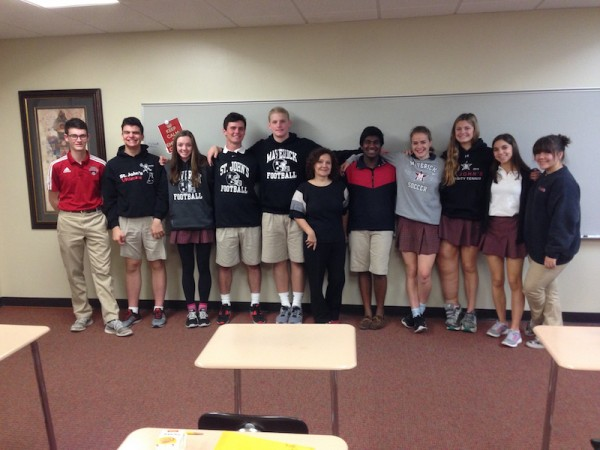 The Math in Contemporary Society class stands with Monica Rhor after her lecture.
