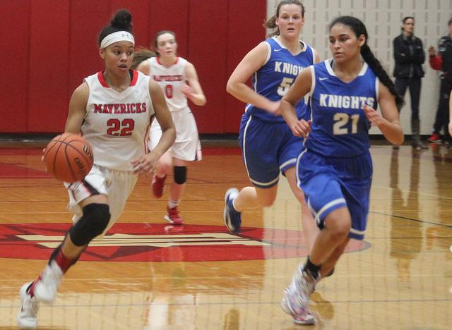 Senior Gabby Otey rushes down the court with possession of the ball.