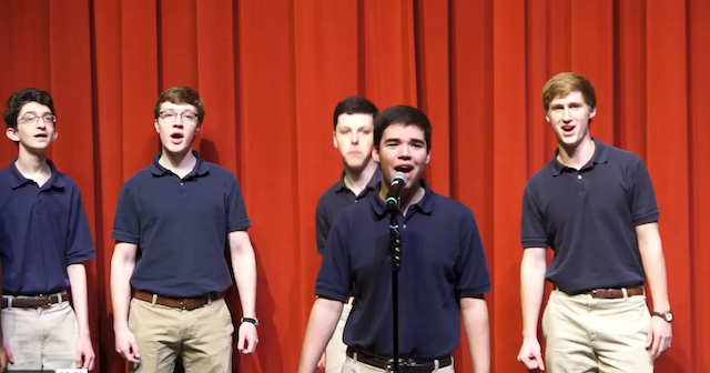 Matthew Brown sings a solo with the a cappella group, Les Chantdudes.