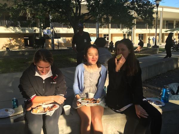 From left: freshmen Isabella Alban, Catherine Gorman, and Josephine Dodd eat lemon squares before the awards ceremony.