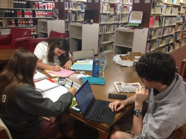 From left: juniors Julia Giordiano, August Schwanauer and Austin Schultz study intensely for their physics and math finals.