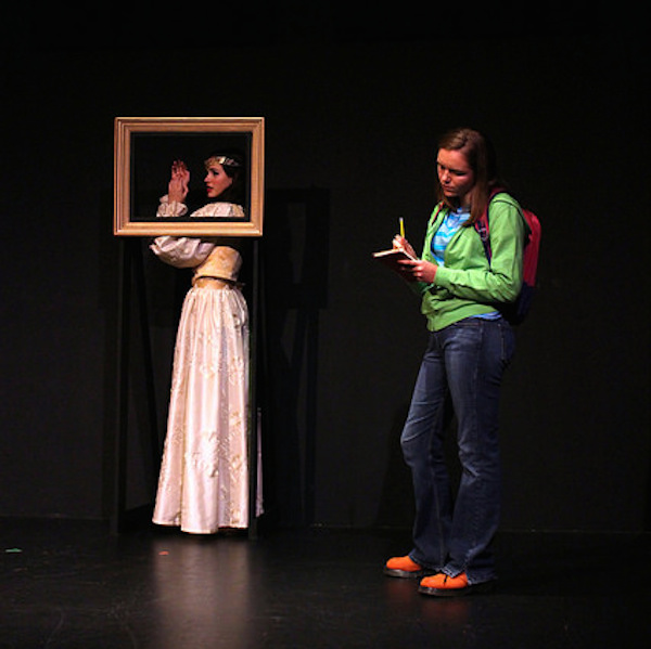 Junior Devon Granberry, playing frustrated high school student Liz, studies the portrait of medieval Italian Elisabetta, played by junior Ella Rose Arnold.