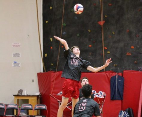 Captain Michael Urdahl jumps for a spike at a game against Kinkaid Sept. 15.