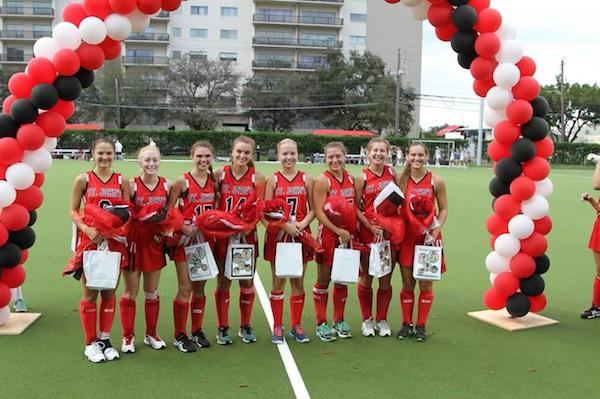 The seniors on Mavericks field hockey with at the ribbon cutting ceremony for the new wet-turf Finnegan field.