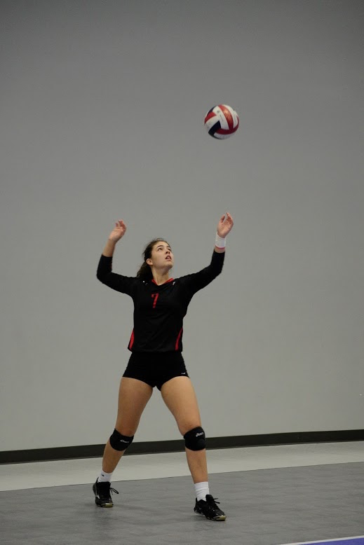 Junior Grace Hansen fires off a serve at the Houston Open Tournament at the Skyline Volleyball Facility. (Anudeep Jain)