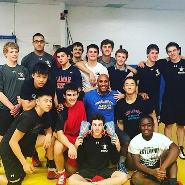 Pictured is Rodriguez with his club wrestling team in 2015, which includes many athletes from St. John's.