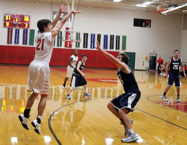 Senior Daniel Perrier, left, plays at the Emery Weiner game at Liu Court.