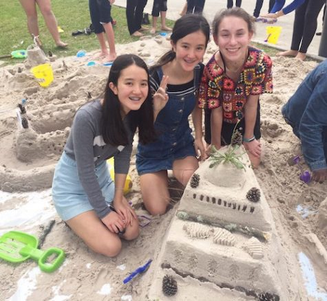 Sophomores Margaret Gorman, Catherine Gorman and Shelby Jordan present their first-place sandcastle, fondly known as the