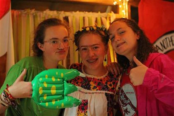 Sophomore Sarah Jane Lasley (left) dressed as a dinosaur with two other friends from Rockbrook. Dressing up is an important part of Banquet.