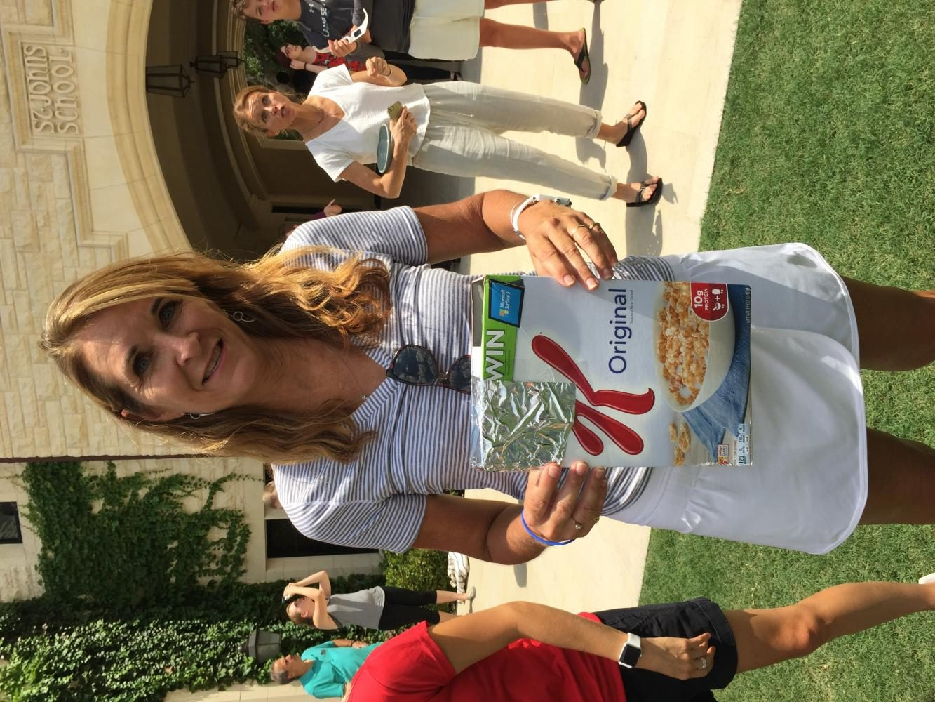 Brenda Mercado shows off her eclipse viewing device, made from a cereal box.