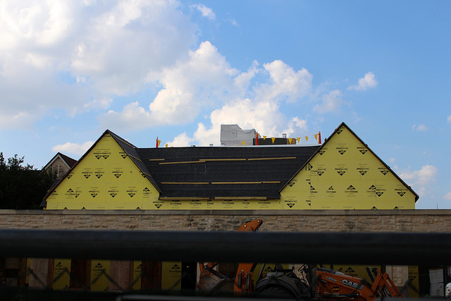 The new multipurpose building is under construction near the Lowe Theater.