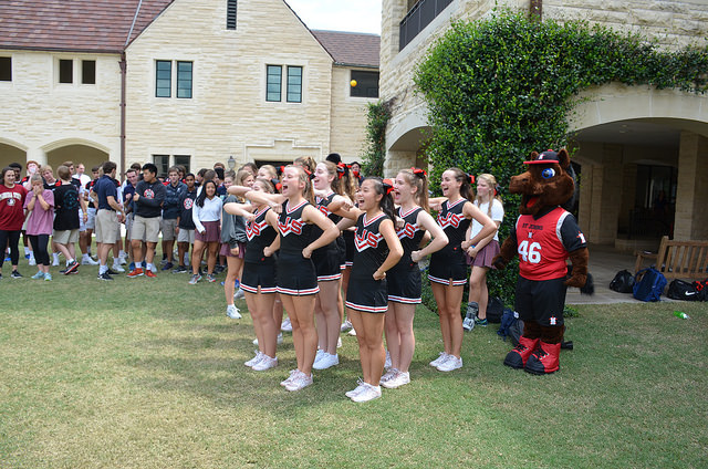The Varsity cheer squad leads students in a cheer.