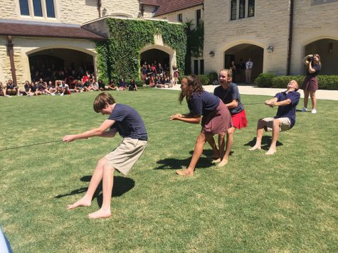 Freshmen face off against sophomores in tug-of-war during the Second Baptist pep rally.