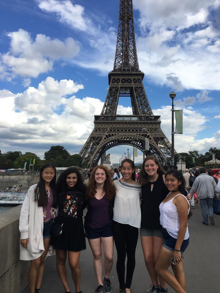 From left: Juniors Emily Feng, Mariela Arreola, Juliette Draper, Elizabeth McNeely, Caroline Burnett and Carlee Marquez stand in front of the Eiffel Tower.