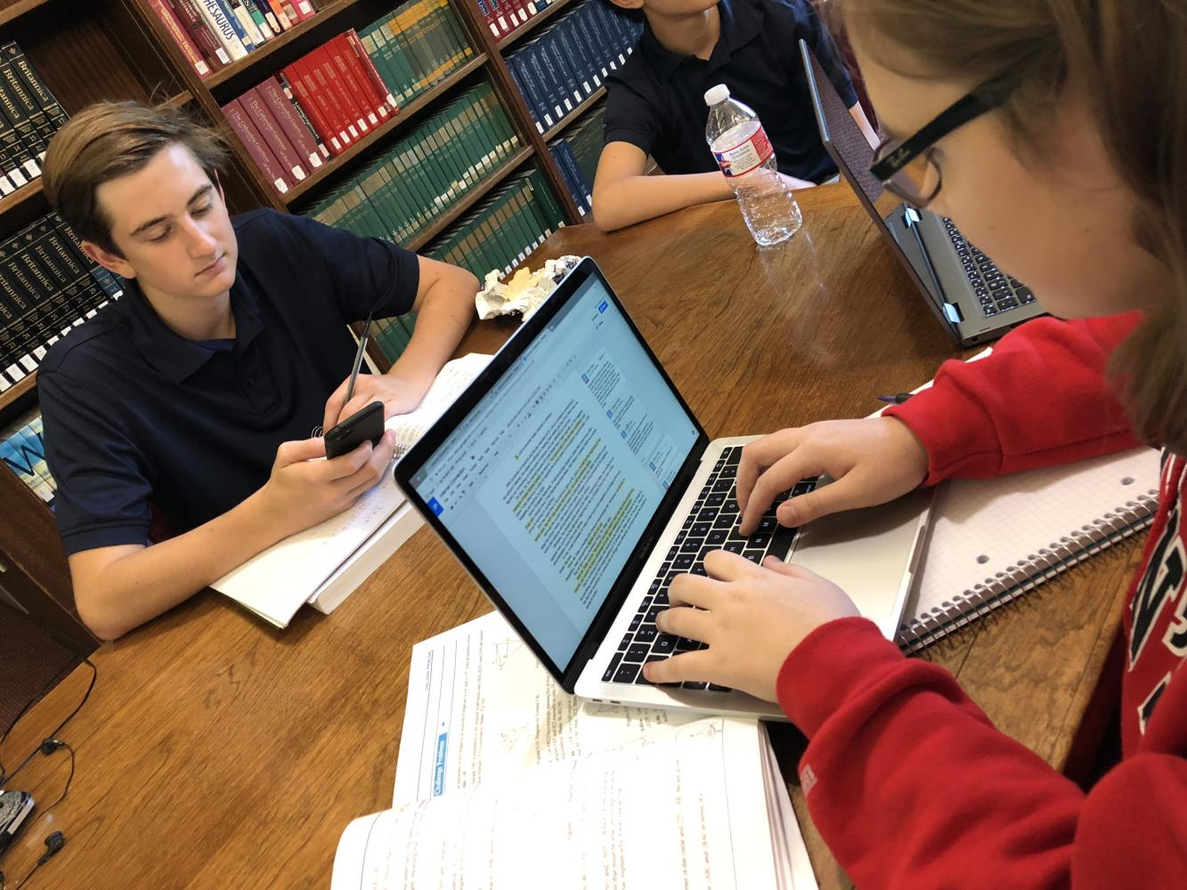 Students enjoy the improved internet as they work in the library.