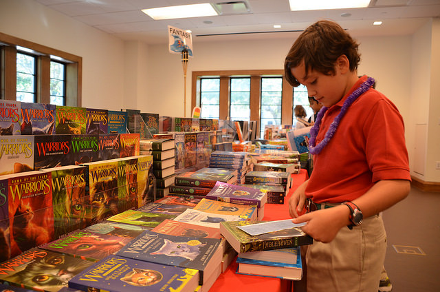 The Book Fair Committee ordered 9,000 books from Barnes and Noble and arranged them in the Campus Center.