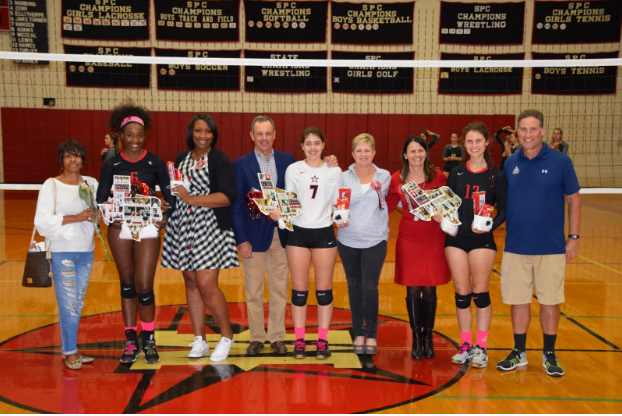 From left: Seniors Kennadie Jake-Turner, Grace Hansen, and Wallis Turley celebrate with their families.