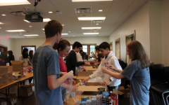 Sophomores sort books, build care packages for class project