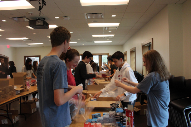 Over+100+sophomores+separated+into+three+service+shifts+to+sort+books+and+care+packages.