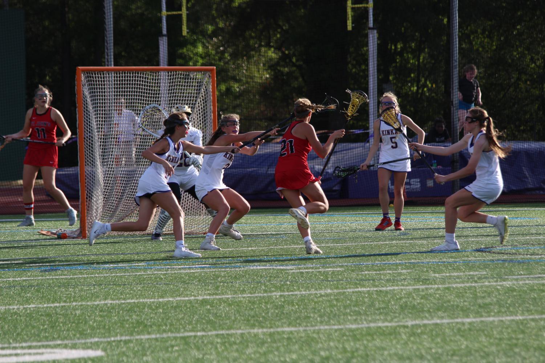 Freshman Caroline Pressler passes several Kinkaid defenders.
