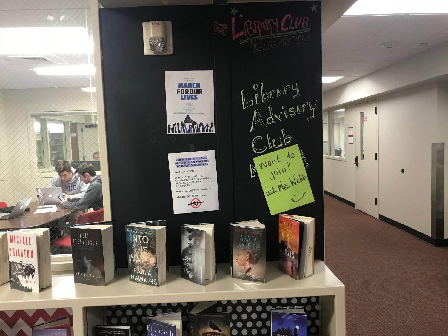 Posters and books on display encourage students to read during the day.