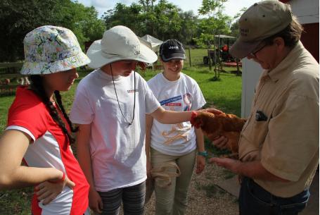 From left: juniors Juliana Aviles and Josephine Dodd and Helen Dodd ('17) visit Rowdy Girl Farm Sanctuary.
