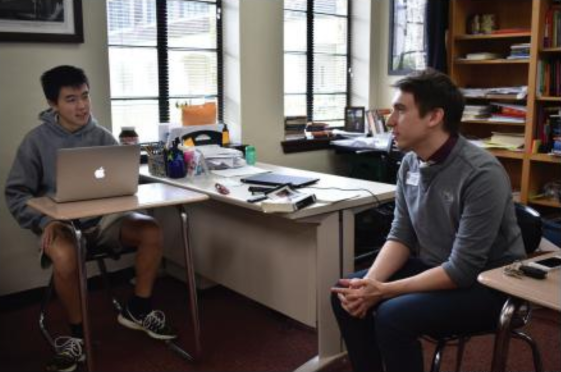 Debate coach Andrew Stubbs advises senior team captain Andrew Wan on his case. Since the implementation of the new schedule, the debate program has grown, leading students to garner a number of awards at local tournaments.