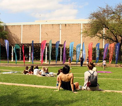 Students relax on the grass outside Hockaday.