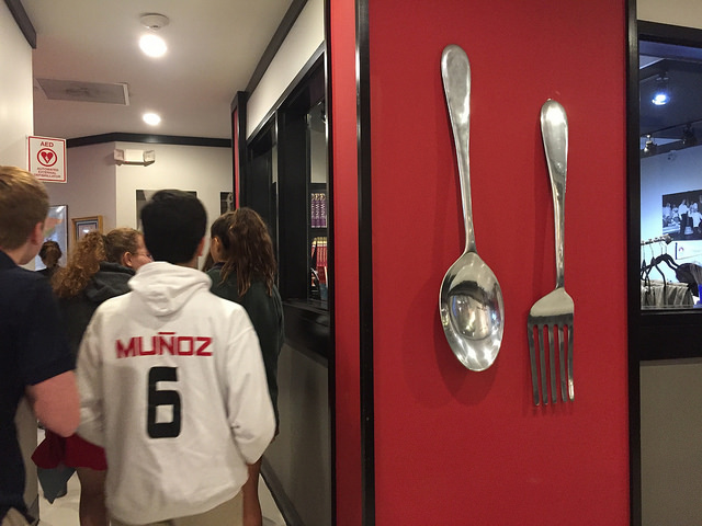 Students tour the hallways of the Culinary Institute Lenôtre and peer into pastry, ice cream and meat