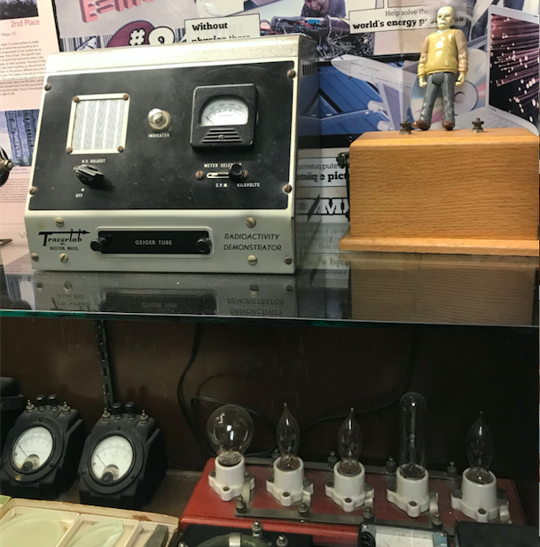 The display case in freshman hallway features several generations' worth of physics equipment.