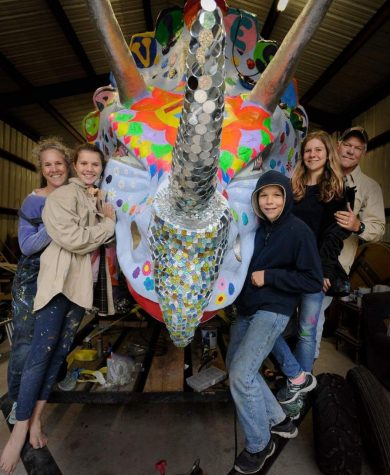 Waters family builds dinosaur art car