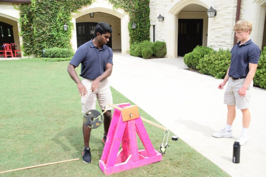 Trebuchet Trial: seniors Prithvi Krishnarao and Cameron May test their trebuchet's range as part of their Physics II (H) project.