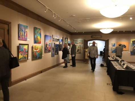 School hosts YMCA auction, showcases refugees' art